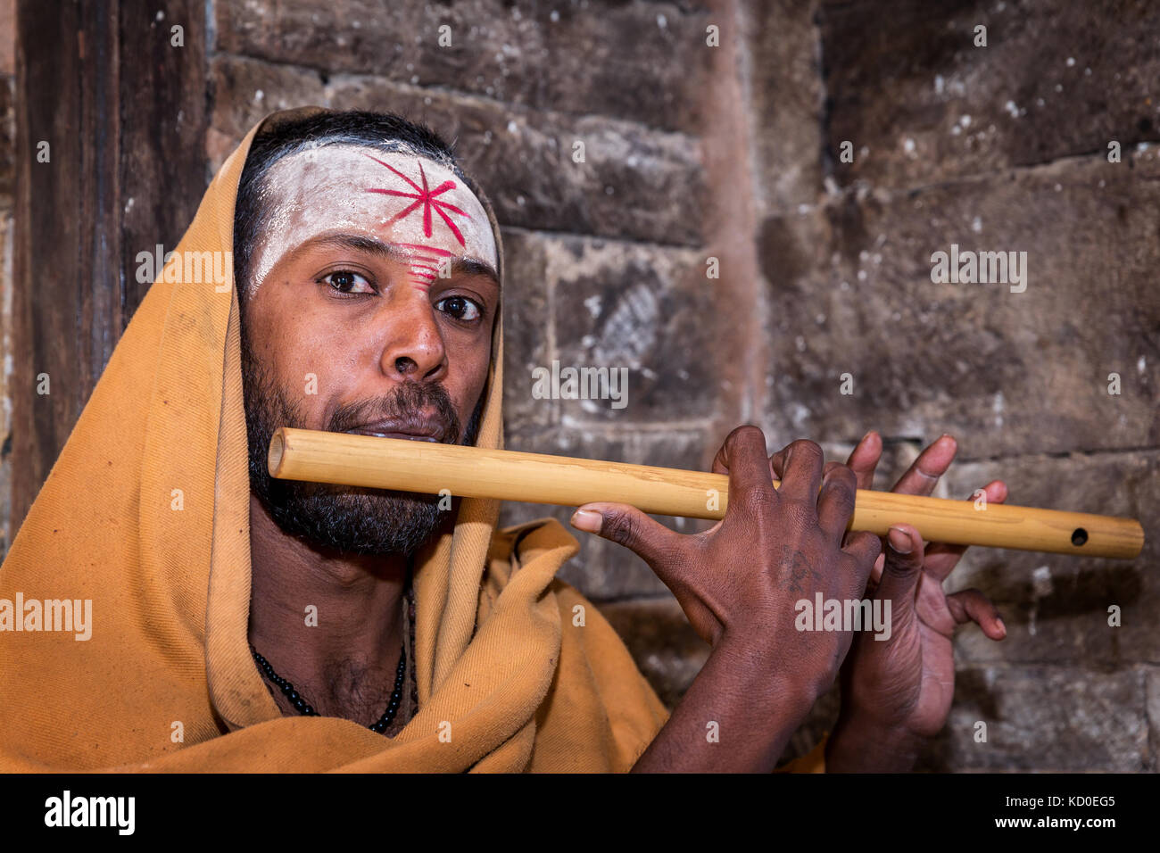 Sadhu or holy man with a flute, Pashupatinath, Kathmandu, Nepal Stock Photo