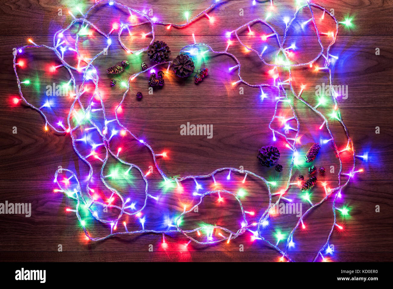 christmas theme background, xmas lights on wooden table with copy