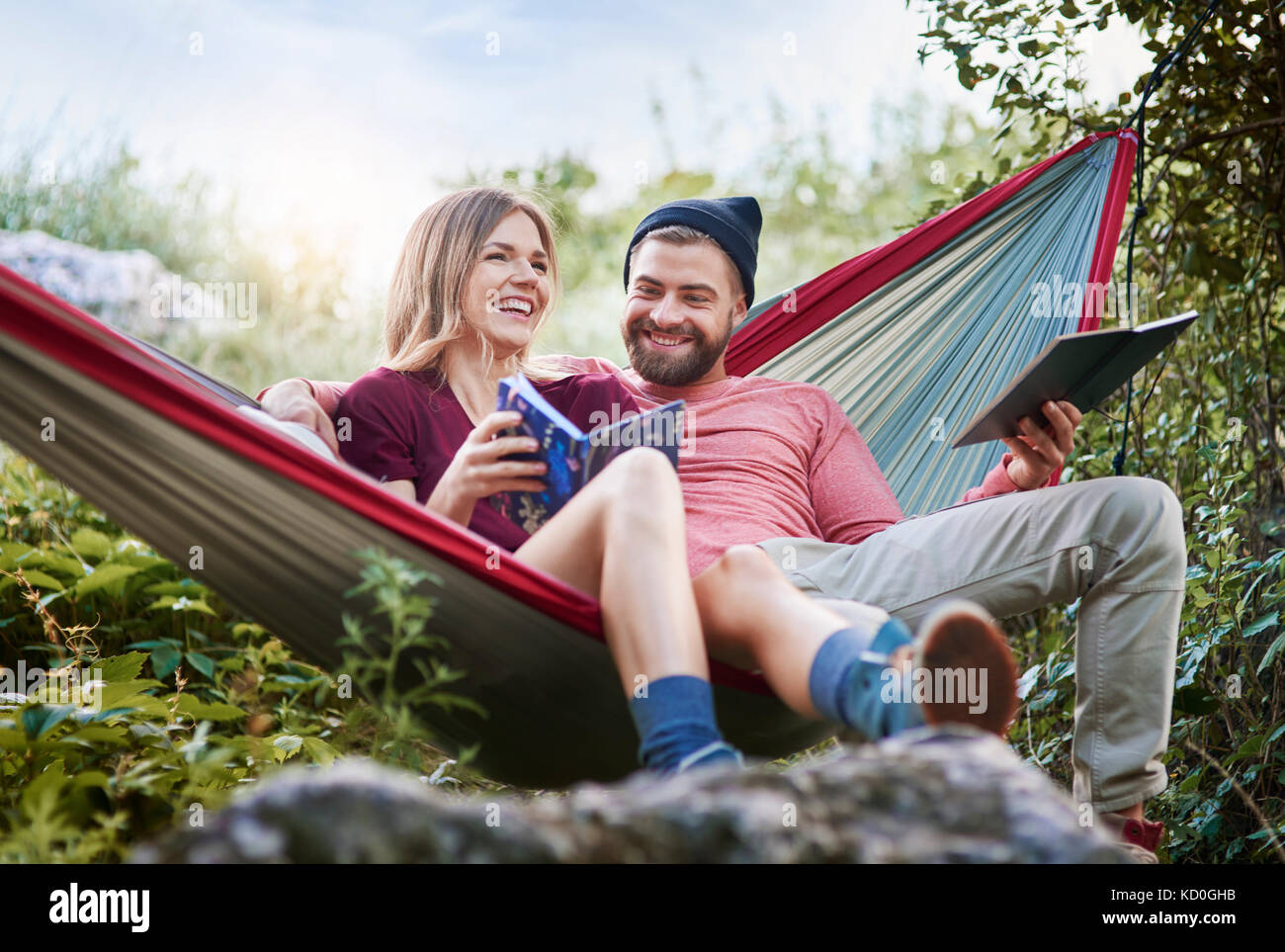 Couple relaxing in hammock, smiling, Krakow, Malopolskie, Poland, Europe - Stock Image
