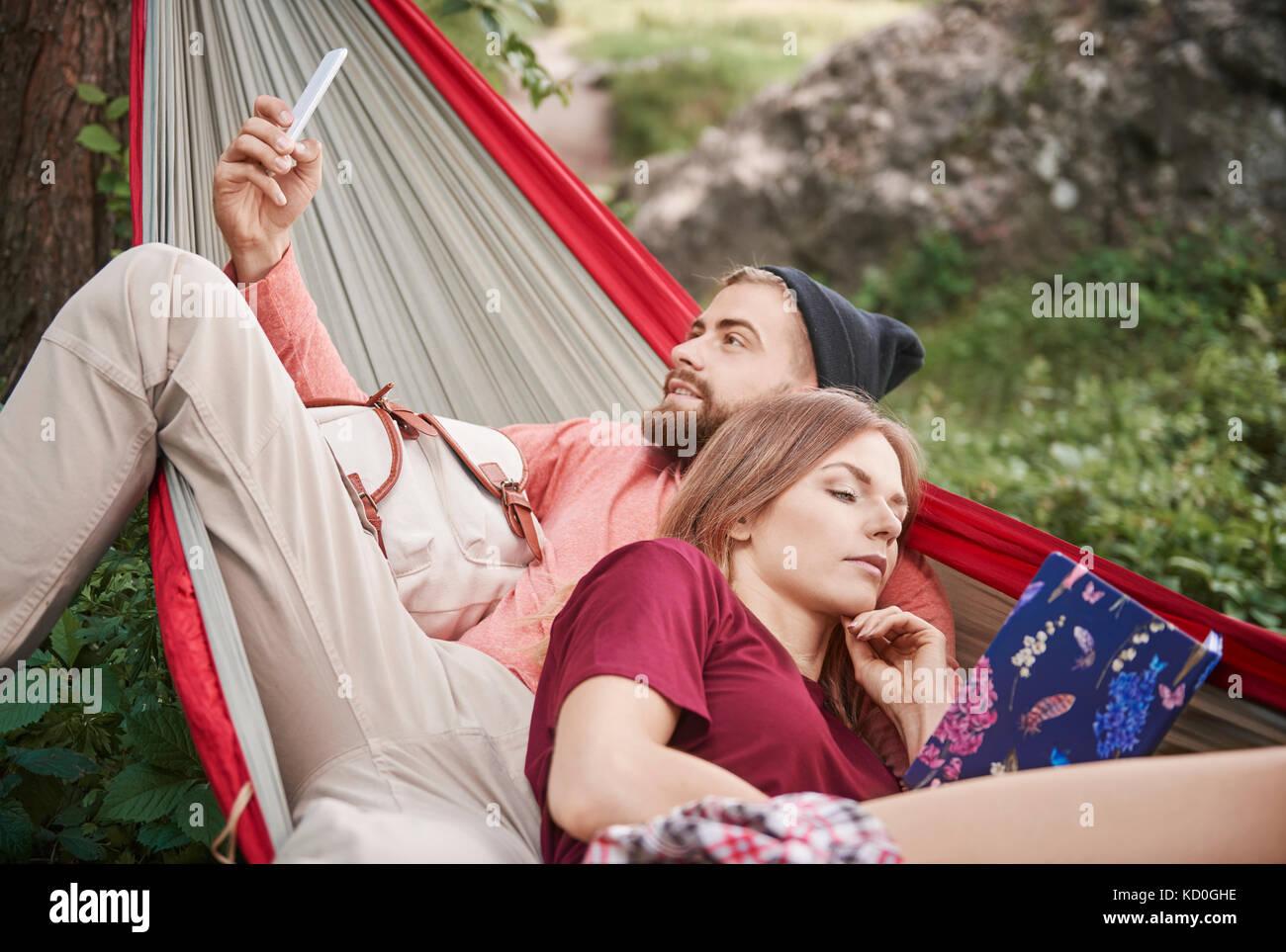 Couple relaxing in hammock, Krakow, Malopolskie, Poland, Europe - Stock Image