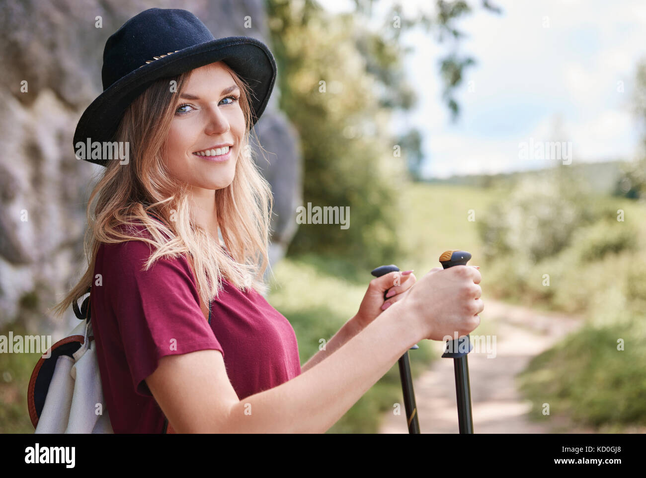 Portrait of woman with walking poles looking at camera smiling, Krakow, Malopolskie, Poland, Europe - Stock Image