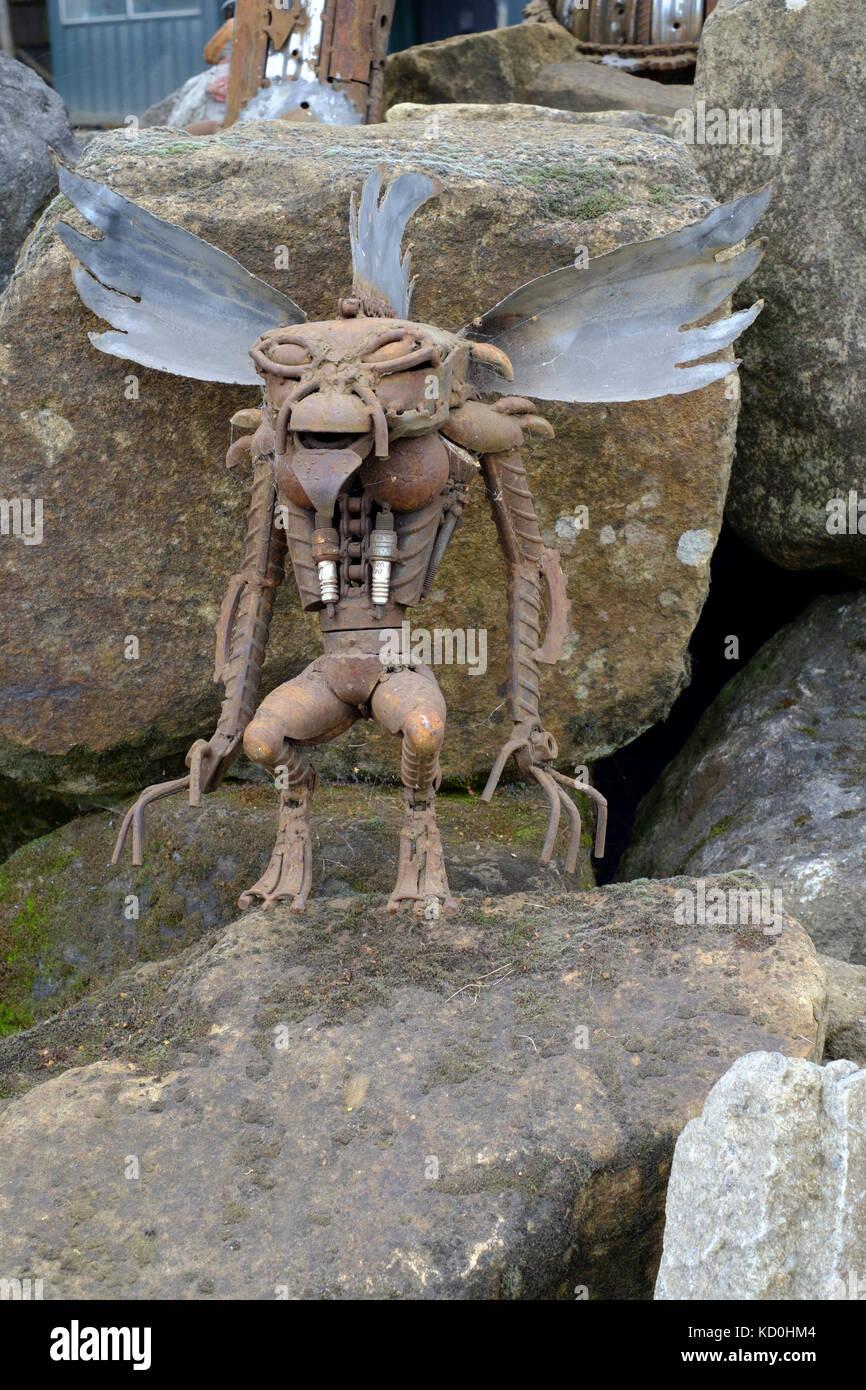 alien sculpture made from scrap car parts at a1 car spares scrapyard at barkham england uk Stock Photo