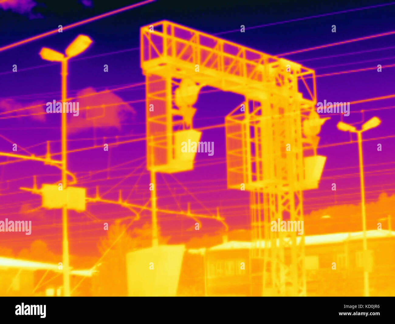 Thermal image of overhead cables at train station - Stock Image