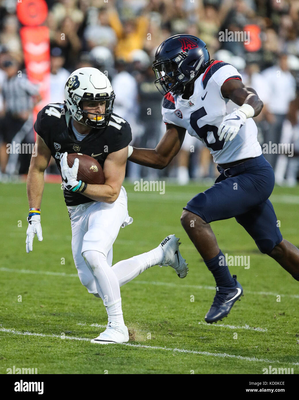 October 7, 2017: Colorado wide receiver Jay MacIntyre is brought down by Arizona's Demtrius Flannigan FOwles - Stock Image