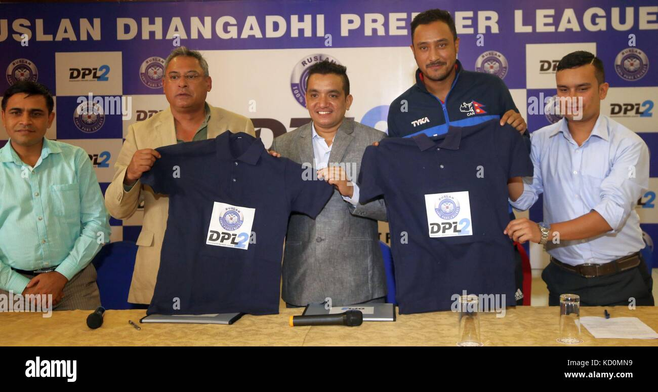 Kathmandu, Nepal. 8th Oct, 2017. Paras Khadka(2nd R), captain of the National Cricket Team, Subash Shahi(C), chairman - Stock Image