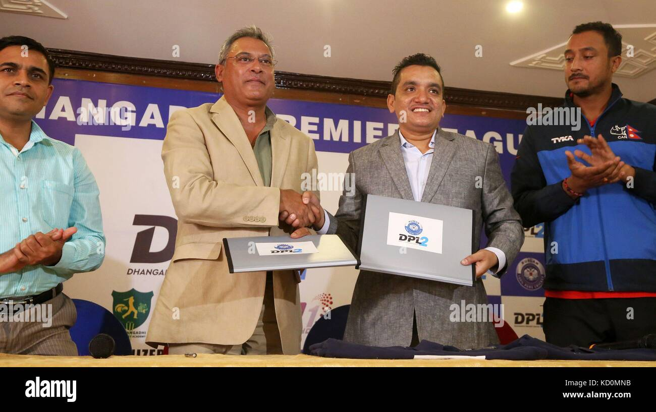 Kathmandu, Nepal. 8th Oct, 2017. Subash Shahi(2nd R), chairman of Dhangadi Cricket Academy, and Shree Harsha Shumsher - Stock Image