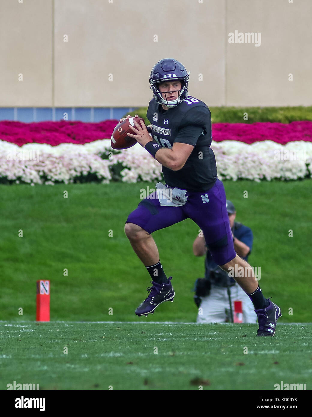 Saturday October 7th - Northwestern Wildcats quarterback Clayton Thorson (18) rolls out to the right while preparing Stock Photo