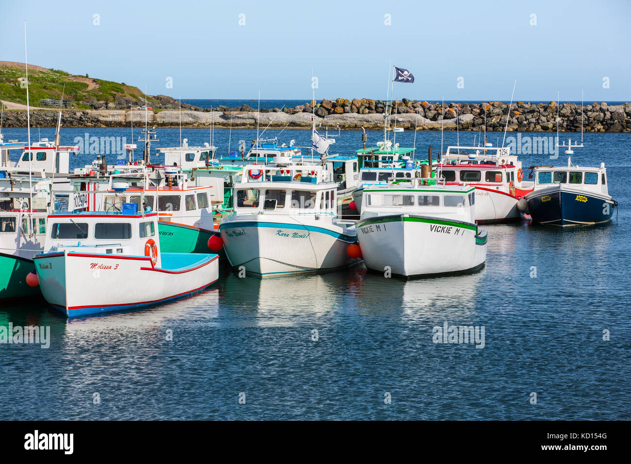 Fishing boats tied up at wharf, Main-A-Dieu, Cape Breton, Nova Scotia, Canada - Stock Image