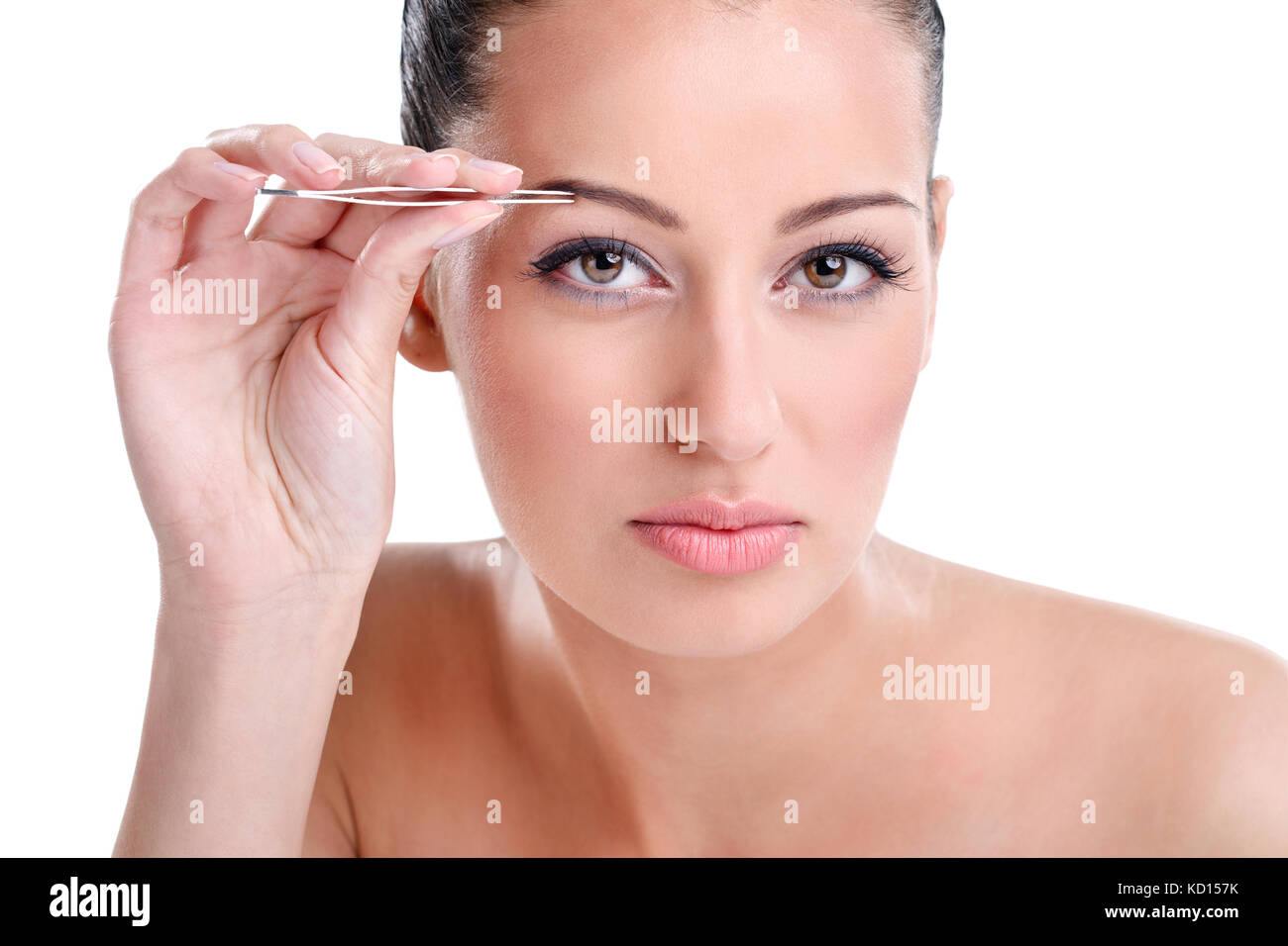 Beautiful Young Woman Plucking Eyebrows Looking At Camera As Mirror