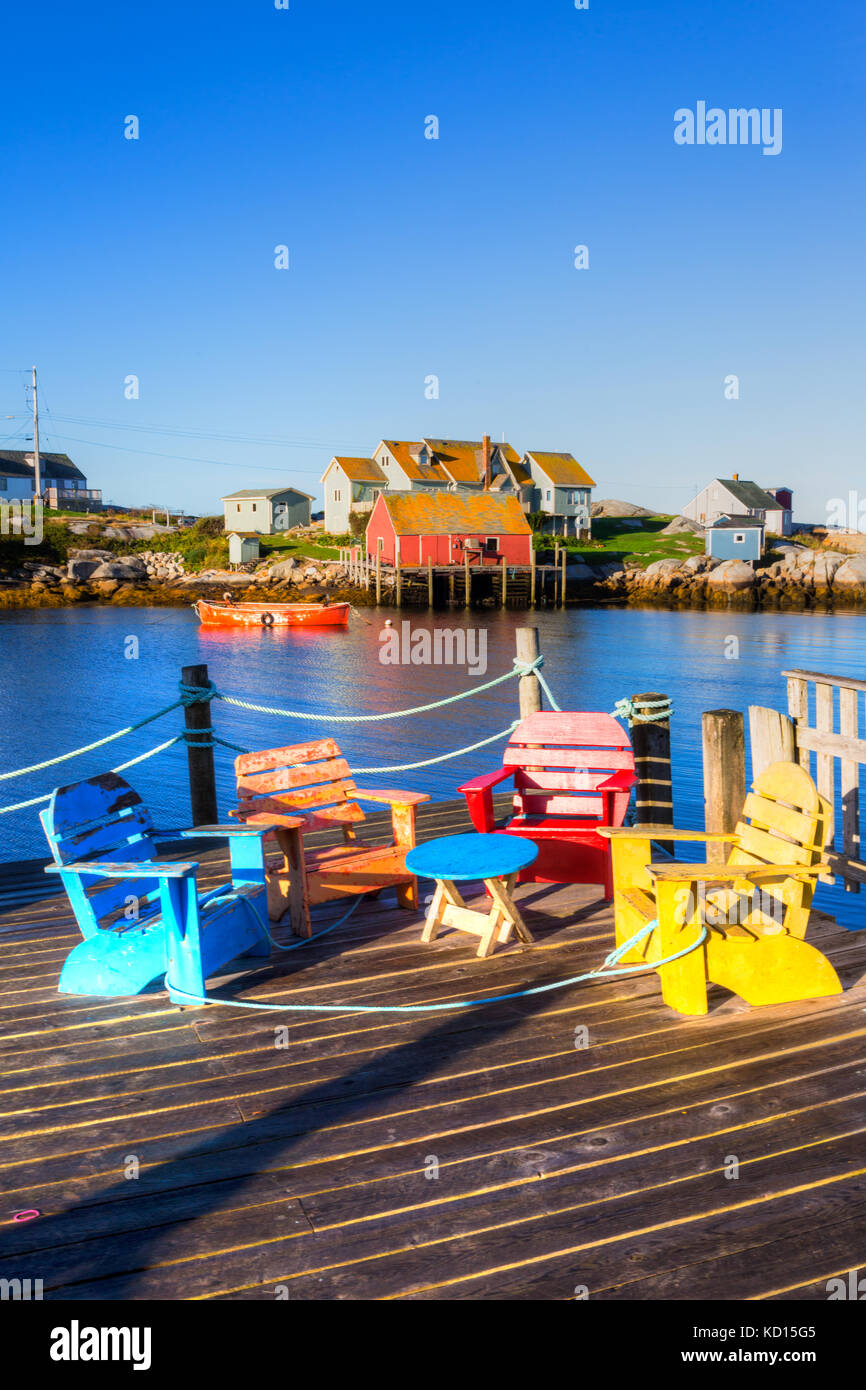 Lawn chairs on wharf, Peggys Cove, Nova Scotia, Canada - Stock Image