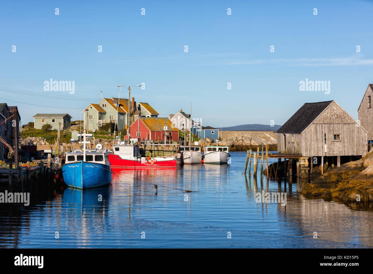 Fishing boats tied up at wharf, Peggys Cove, Nova Scotia - Stock Image