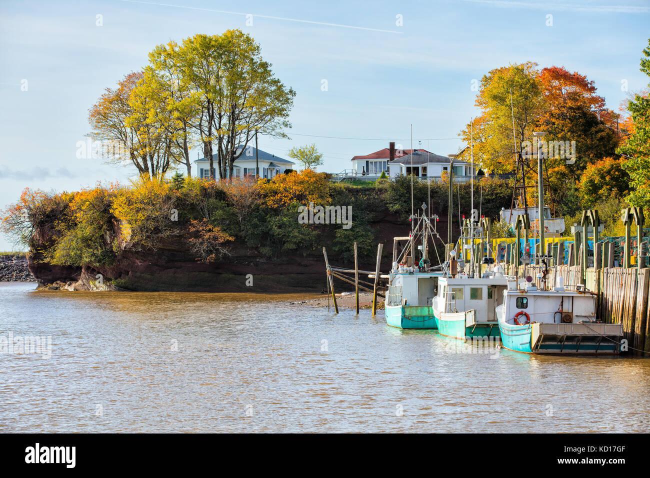 Fishing boats tied up at wharf, St. Martins, Bay of Fundy, New Brunswick, Canada - Stock Image