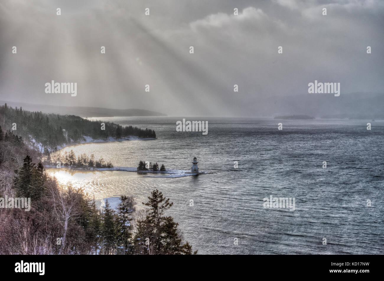 View of McNeil Beach Lighthouse in winter from Seal Island Bridge Bras Dor Lakes, Cape Breton, Nova Scotia, Canada - Stock Image