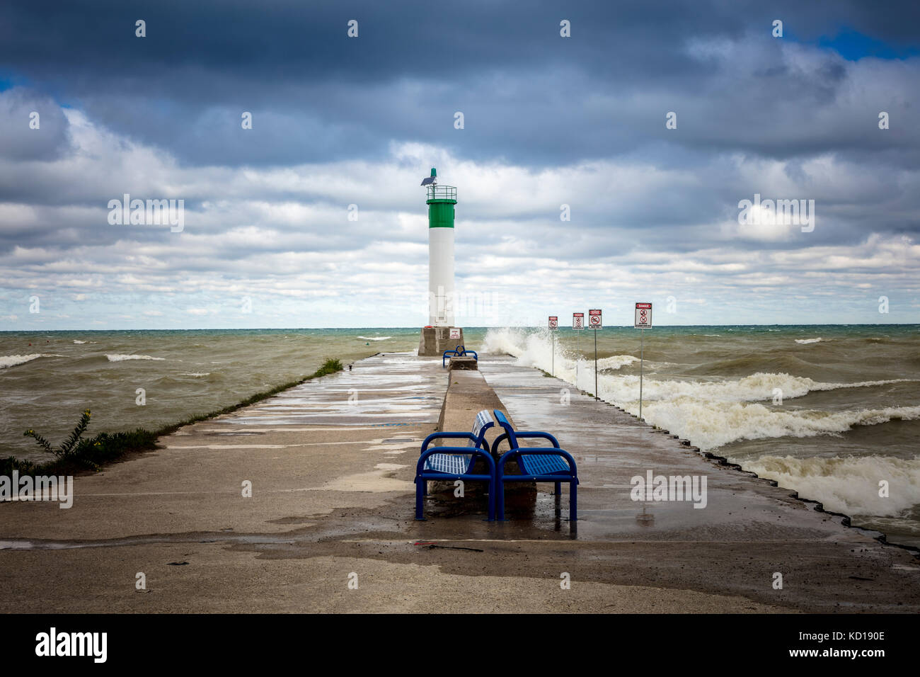 Waves hitting the pier at the mouth of Parkhill Creek at Lake Huron in Grand Bend, Ontario, Canada - Stock Image