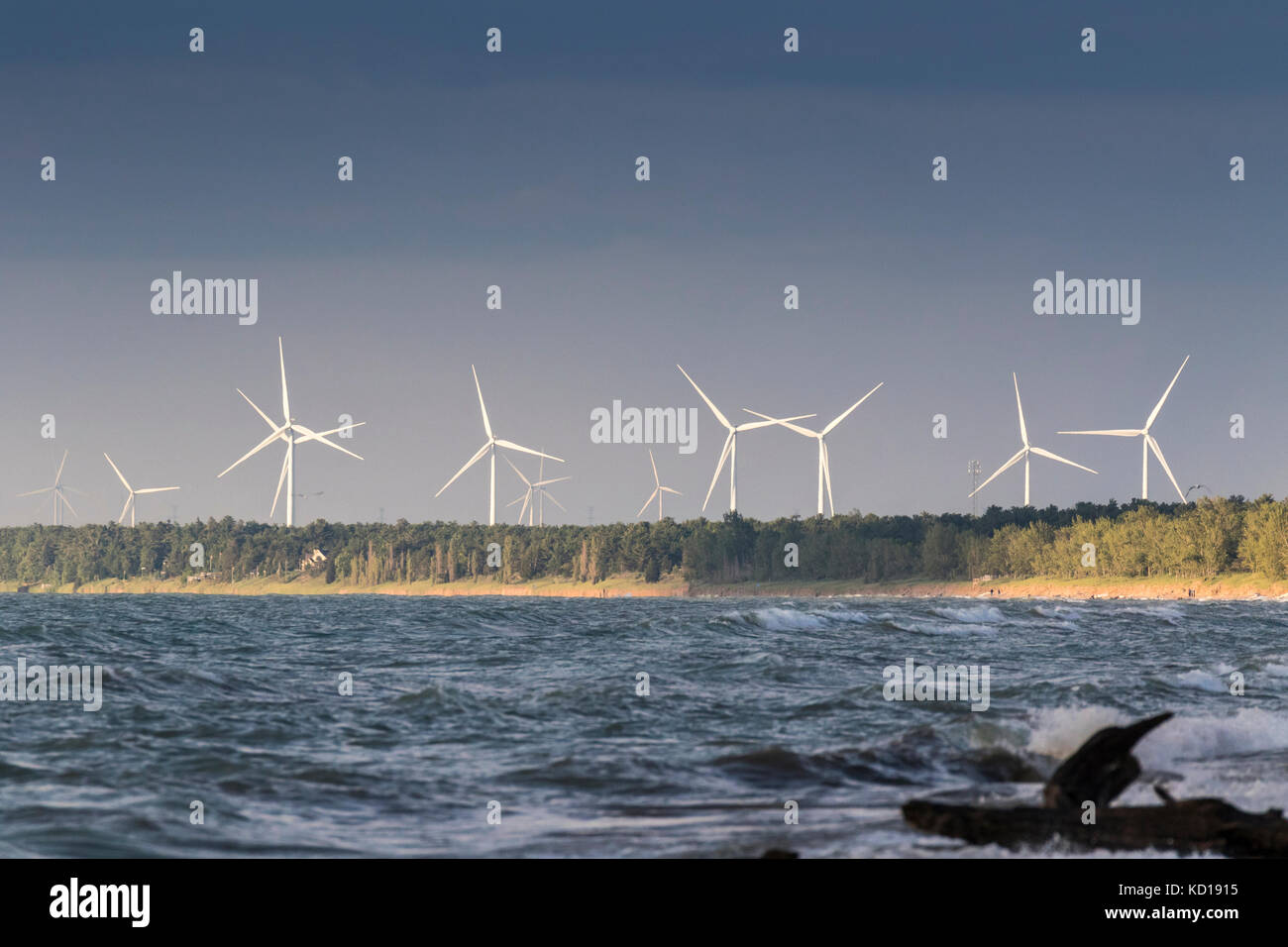 Windmills over Lake Huron at Grand Bend (Lambton Shores) as seen from the Pinery Provincial Park, Ontario, Canada - Stock Image