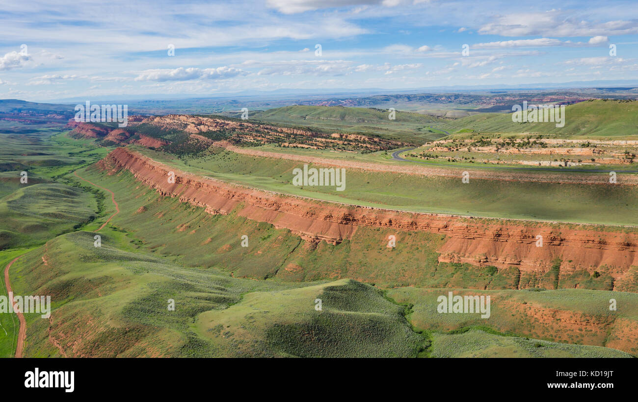 Drone flight from high above Wyoming's Red Canyon rock formation. - Stock Image