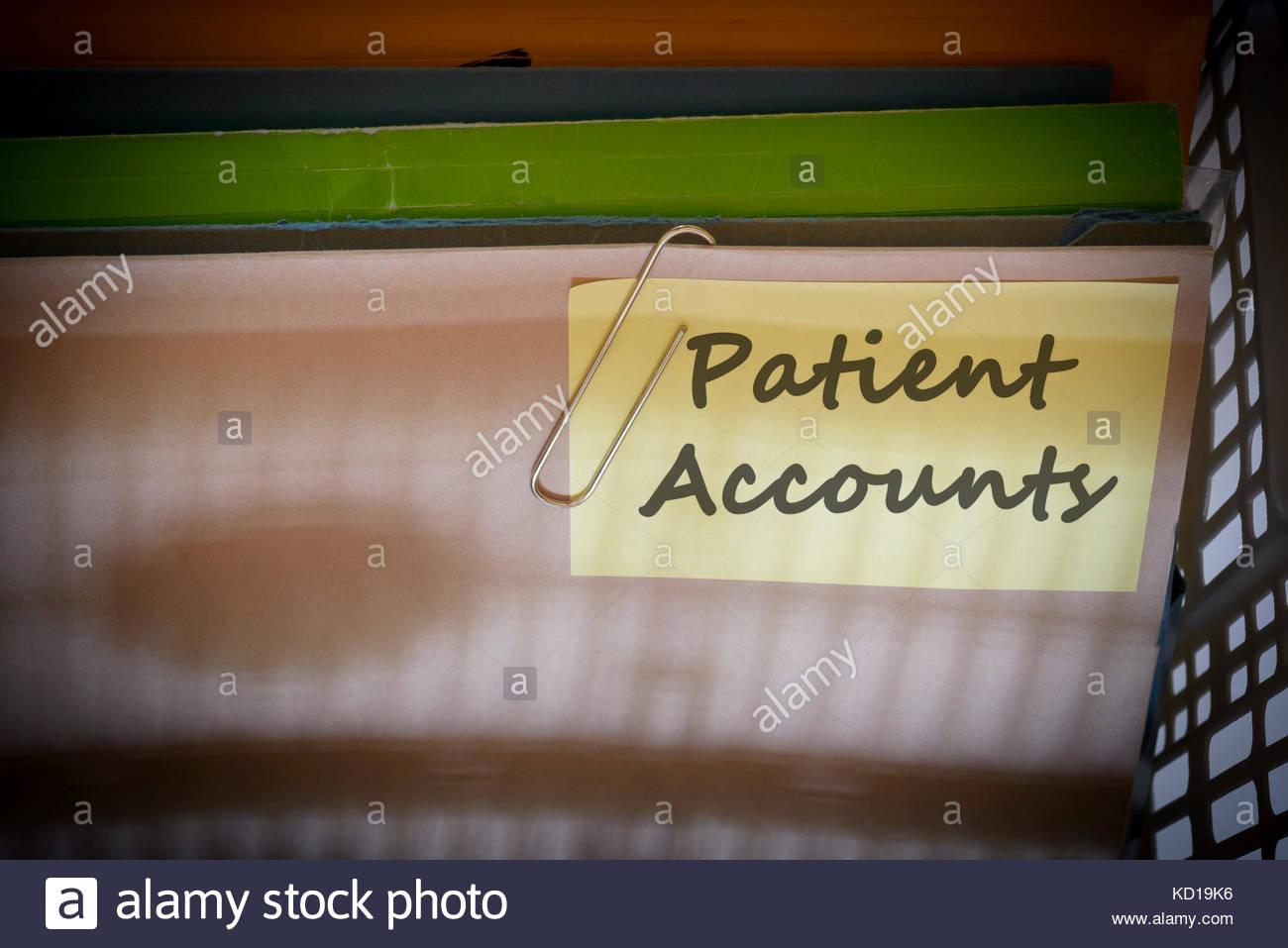 Patient Accounts written on document folder, Dorset, England. - Stock Image