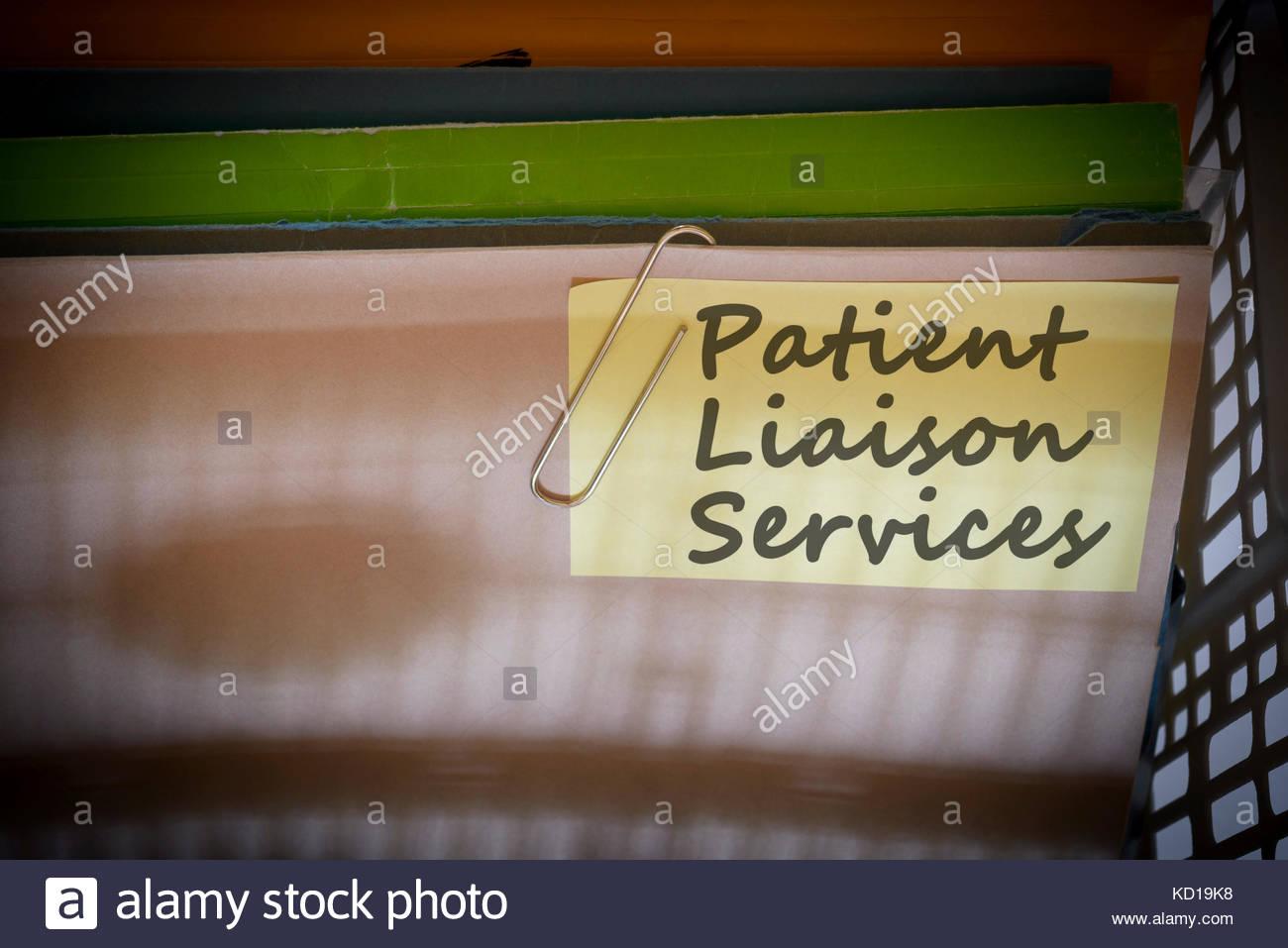 Patient Liaison Services written on document folder, Dorset, England. - Stock Image