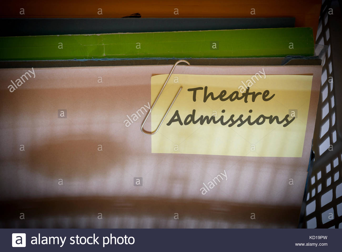 Theatre Admissions written on document folder, Dorset, England. - Stock Image