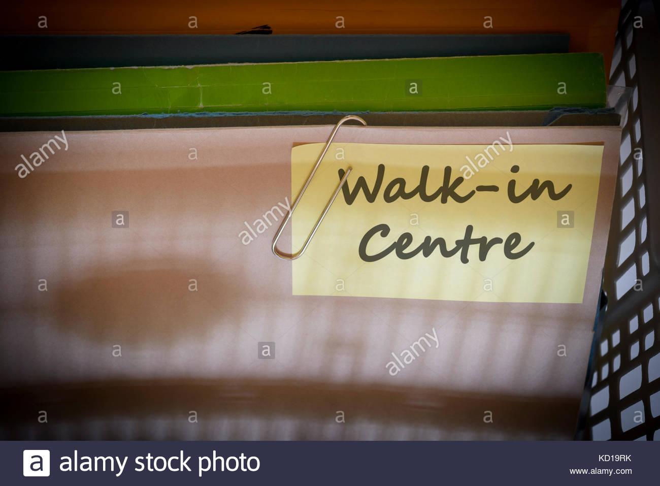 Walk-in Centre written on document folder, Dorset, England. - Stock Image
