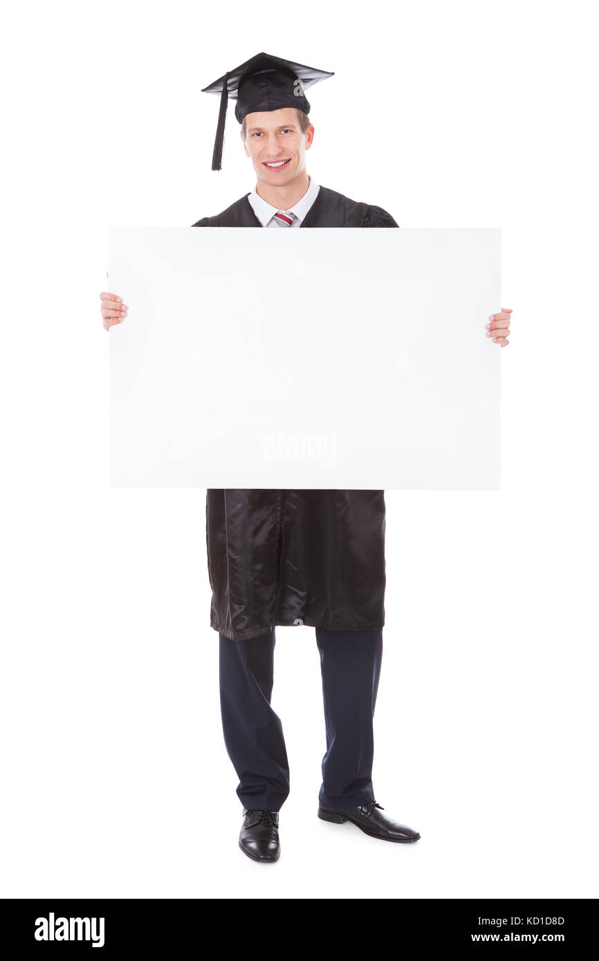 Young Graduate Man Holding White Billboard Over White Background - Stock Image