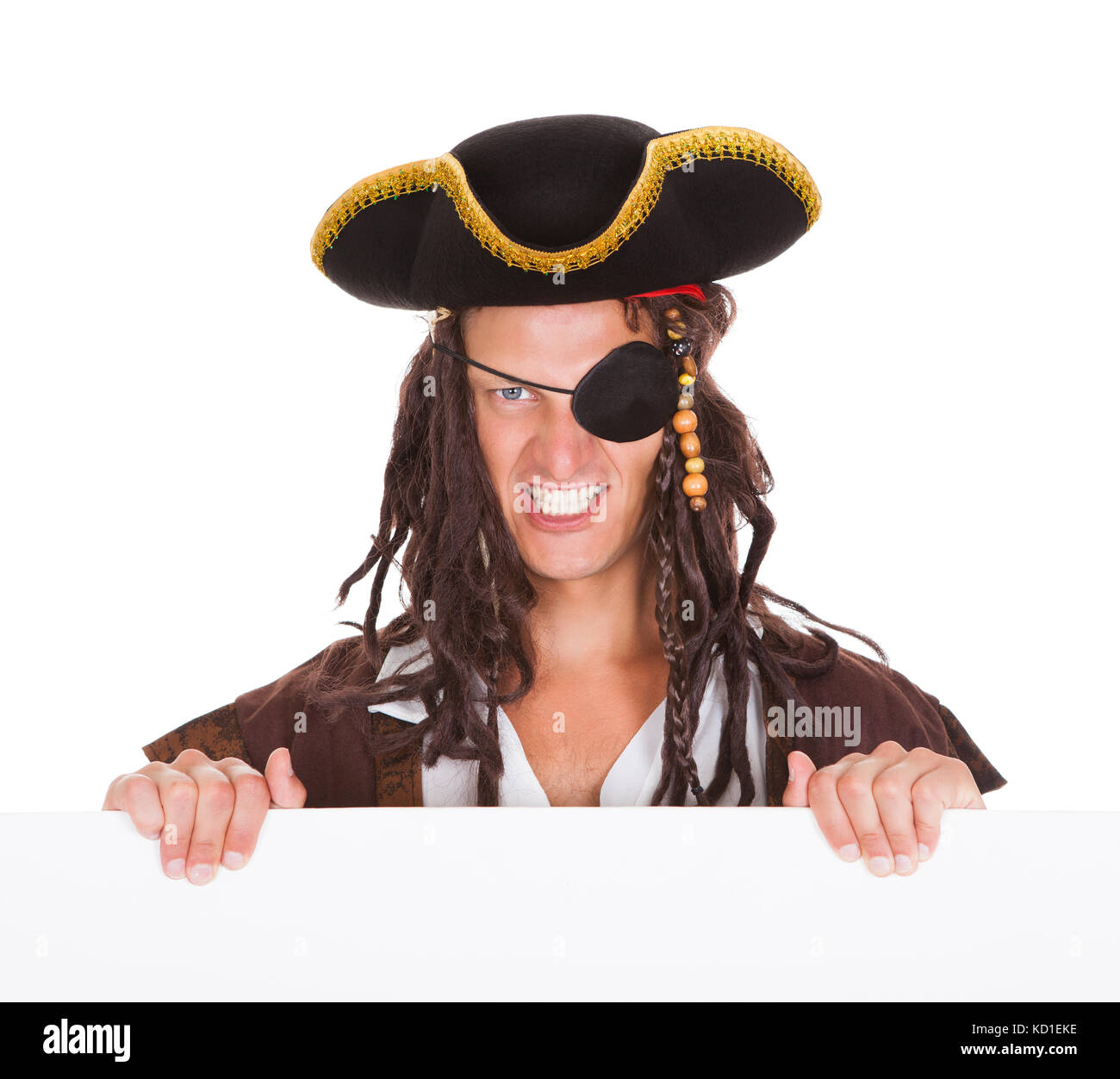 Angry Pirate Holding Blank Placard In Mouth On White Background - Stock Image