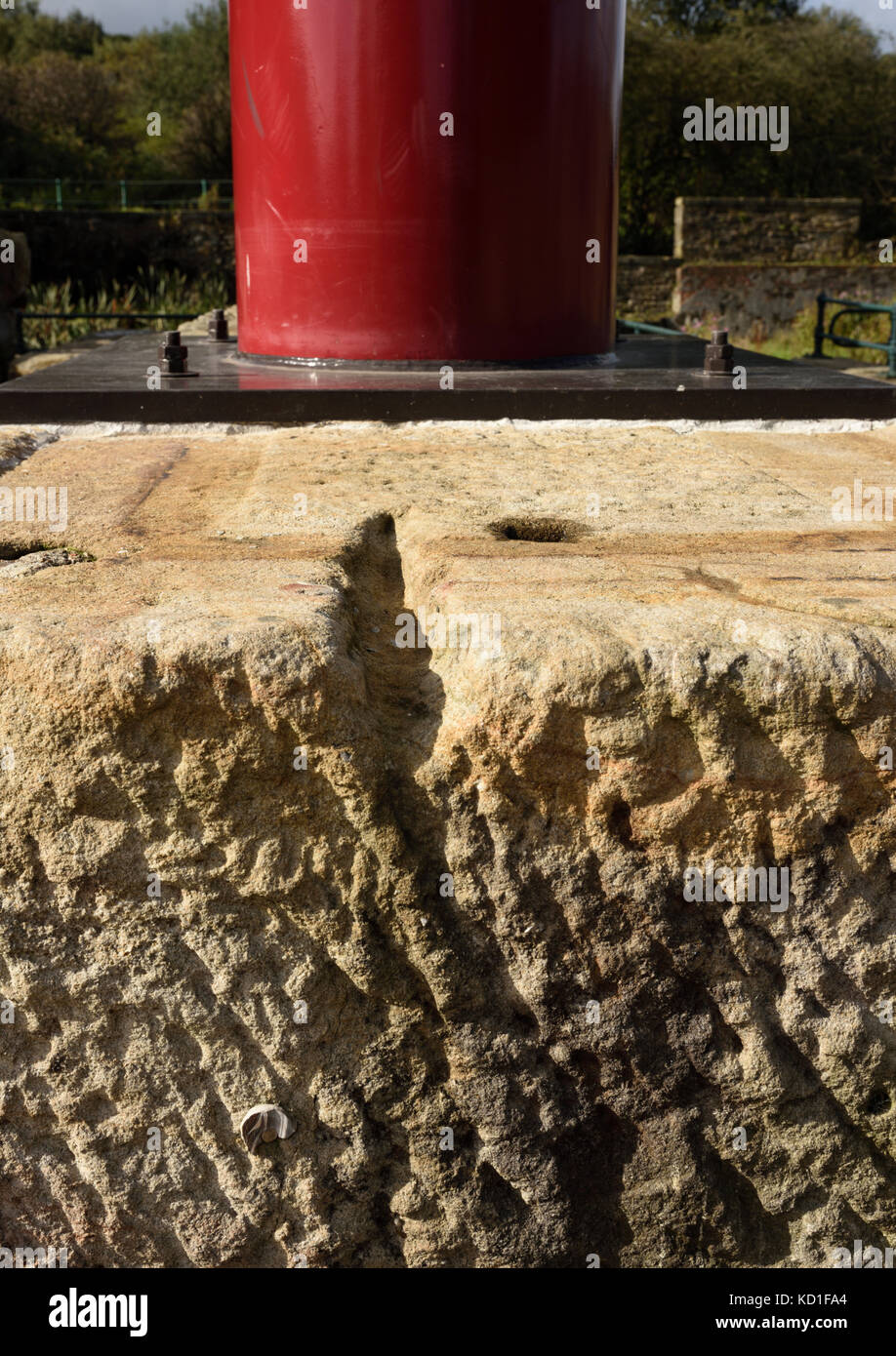 Steel plate at base of sculpture fixed  to stone block with anchor fasterners at burrs country park in bury lancashire - Stock Image