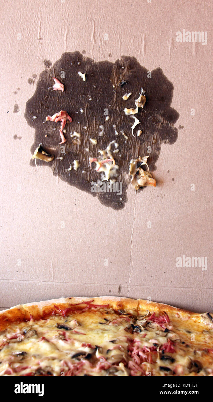 picture of a Fresh baked pizza and fleck on packaging carton box - Stock Image