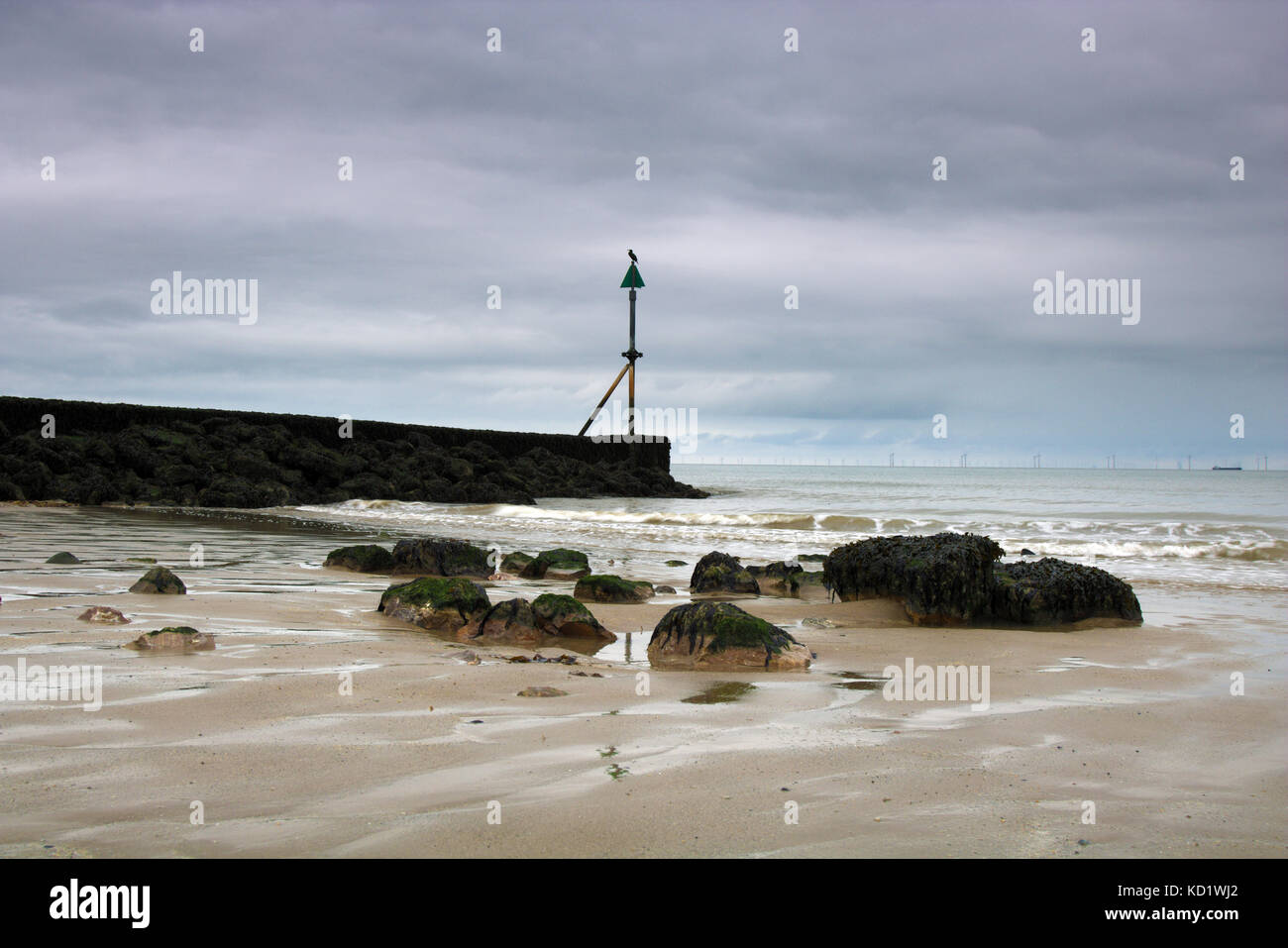 View of a tide breaker looking out across the irish sea. - Stock Image