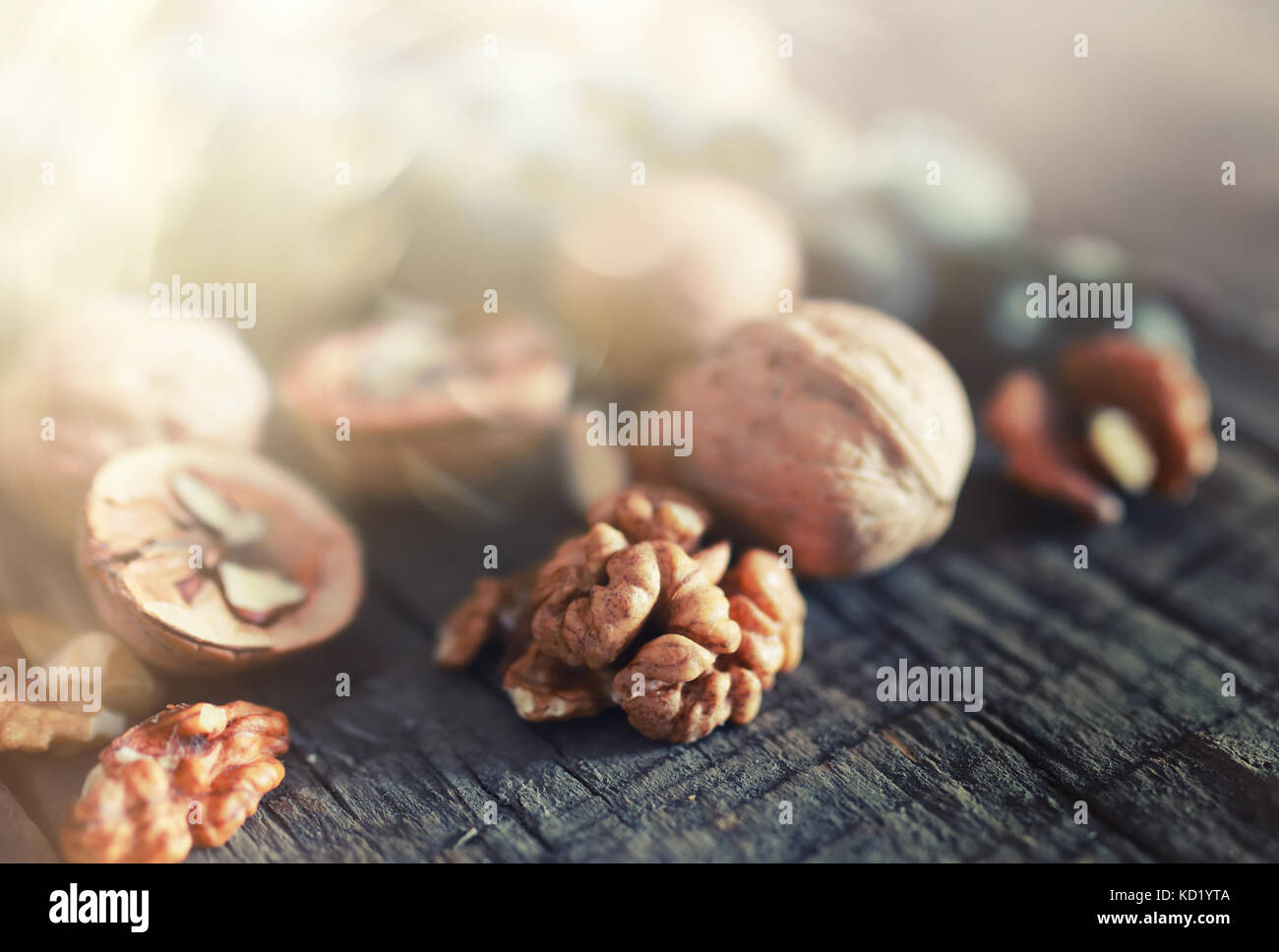 walnuts, whole and peeled wooden background - Stock Image