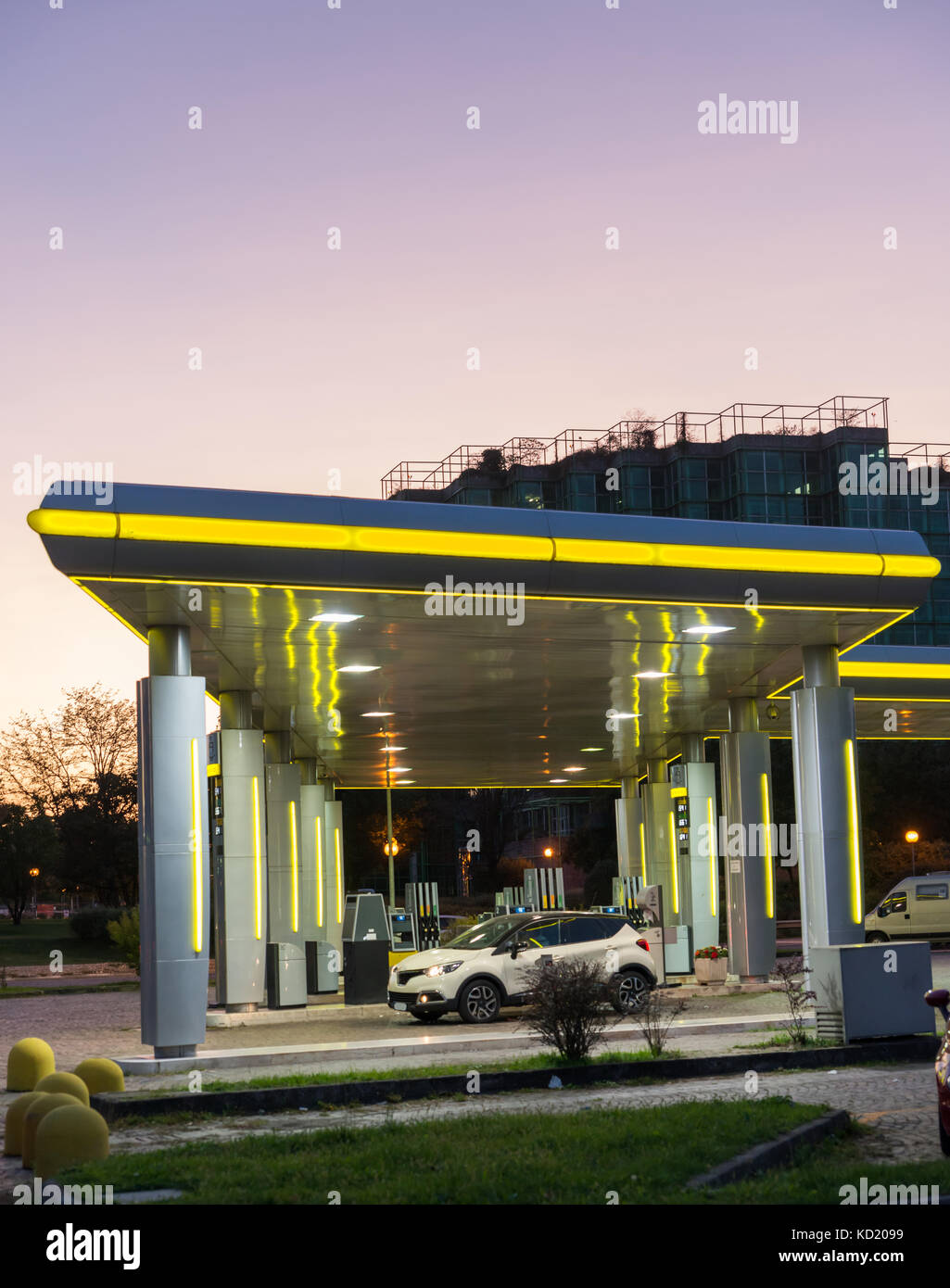 A petrol station at blue hour with copy space - Stock Image