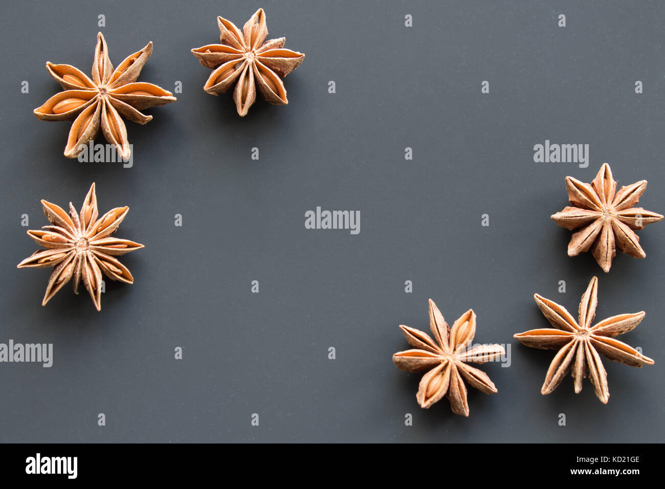 star anise on a black background. - Stock Image