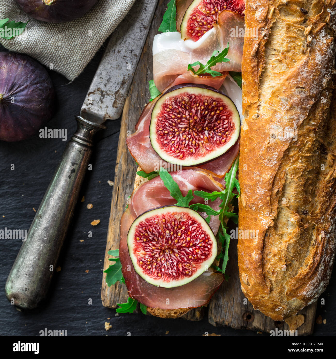 Sandwich with figs and prosciutto - Stock Image