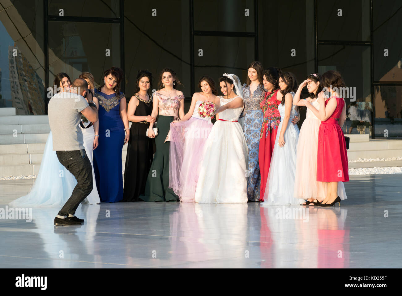 Photographer taking photos of a beautiful bride with her bridesmaids and friends, Baku, Azerbaijan - Stock Image