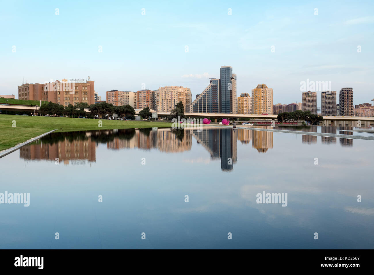 Baku, Azerbaijan - May 19, 2017 : city skyline reflected in a lake, modern architecture - Stock Image