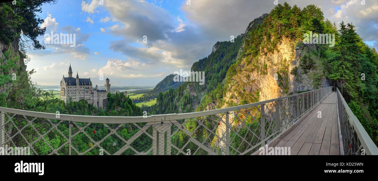 Side shot of Neuschwanstein Castle and bridge, near Füssen in southwest Bavaria, Germany. - Stock Image