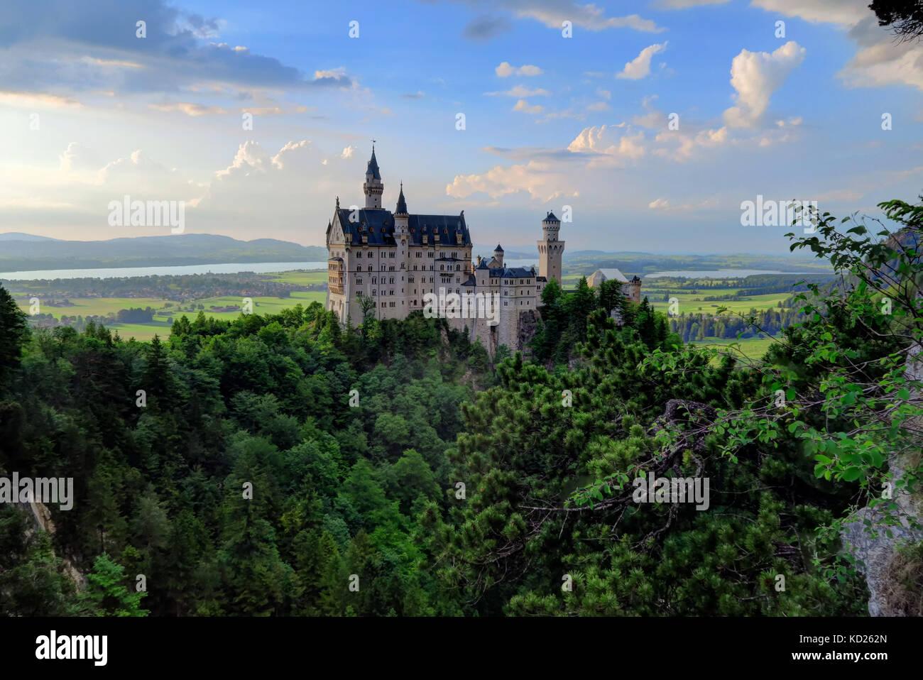 Back behind shot of Neuschwanstein Castle, valley, and village of Hohenschwangau, near Füssen in southwest - Stock Image