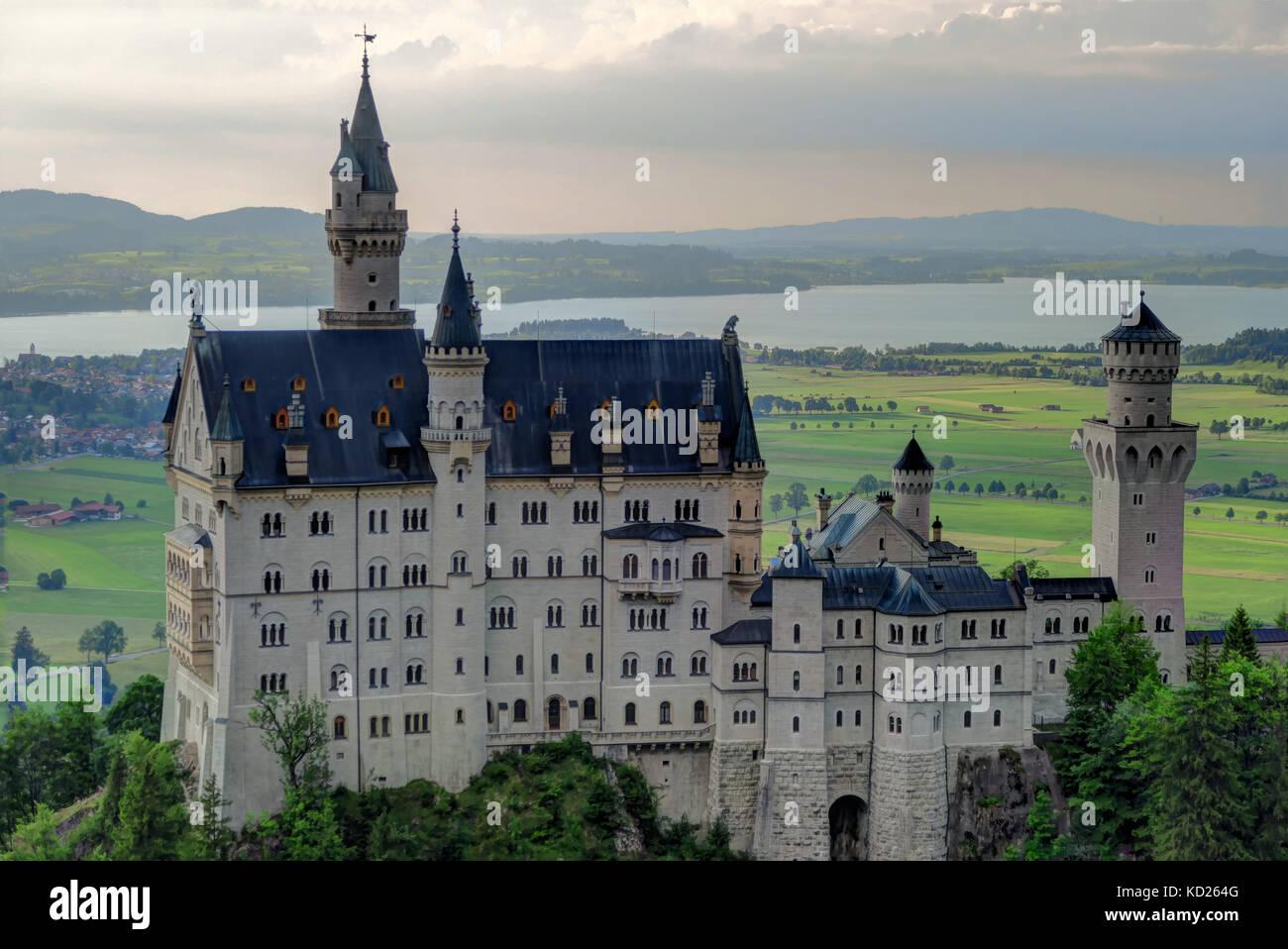 Back behind shot of Neuschwanstein Castle and valley, near Füssen in southwest Bavaria, Germany. - Stock Image