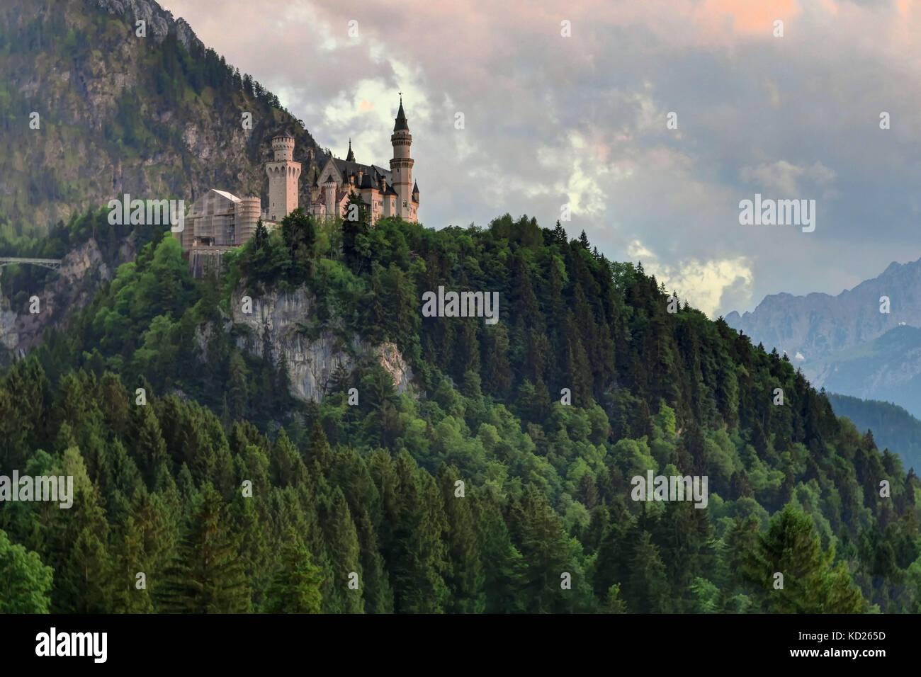 Front shot of Neuschwanstein Castle and forest, near Füssen in southwest Bavaria, Germany. - Stock Image