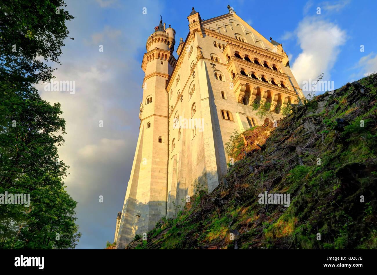 Front and bottom shot of Neuschwanstein Castle and village of Hohenschwangau, near Füssen in southwest Bavaria, - Stock Image