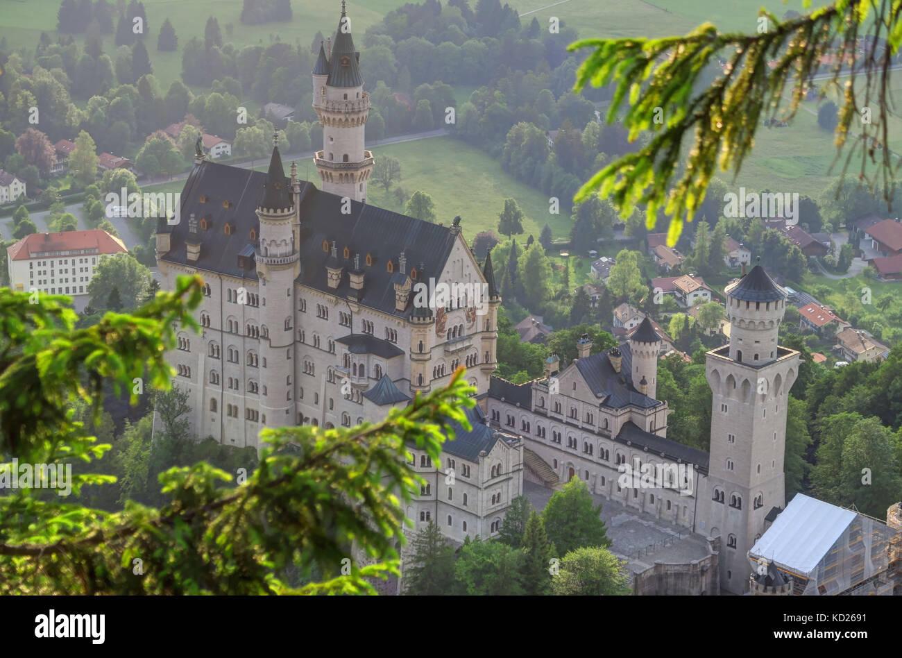 Aerial shot of Neuschwanstein Castle and village of Hohenschwangau near Füssen in southwest Bavaria, Germany. - Stock Image