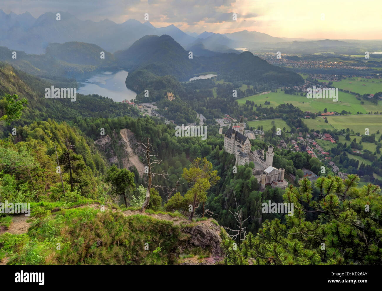 Aerial shot of castle and village of Hohenschwangau, Alpsee Lake, and Schwansee Lake, near Füssen in southwest - Stock Image
