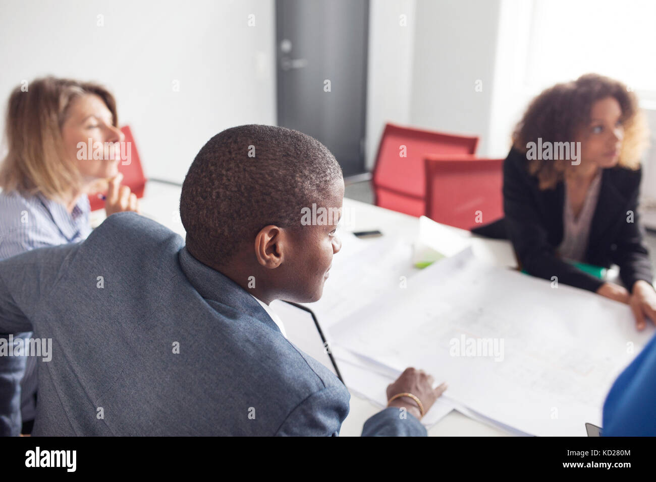 Team of architects and project managers meeting in office - Stock Image