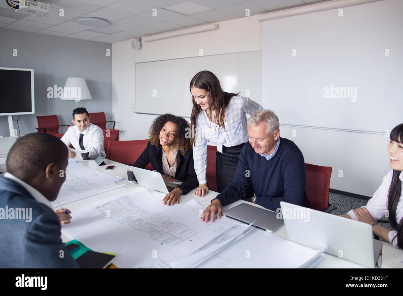 Team of architects and project managers working in office - Stock Image