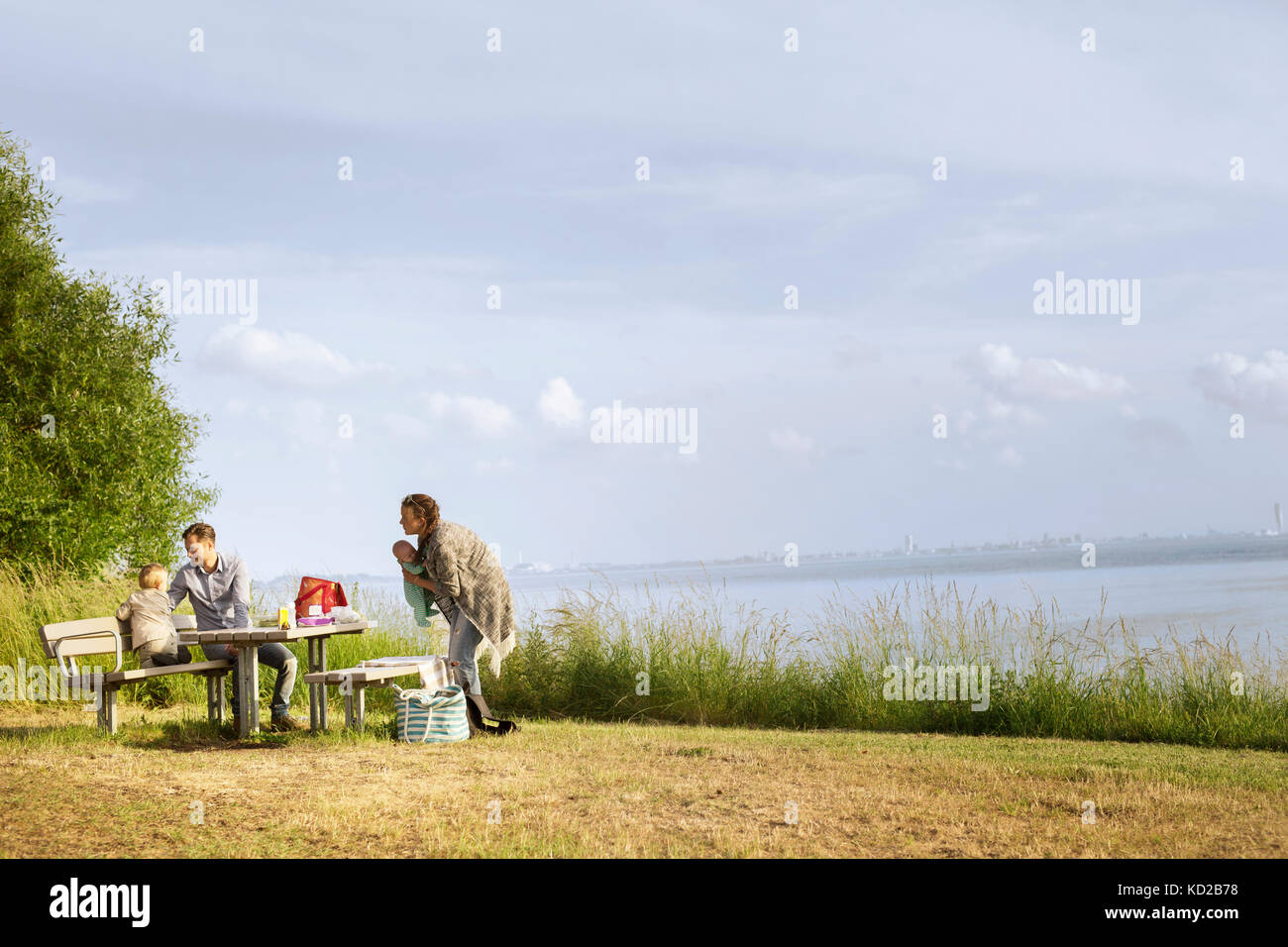Family resting by sea Stock Photo