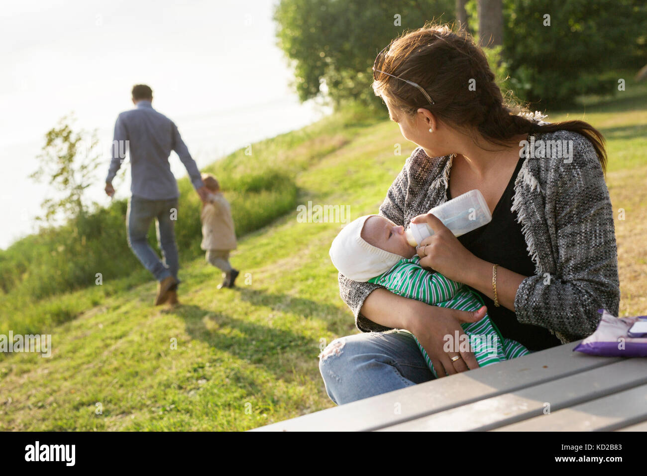 Mother feeding son (0-1 months) Stock Photo