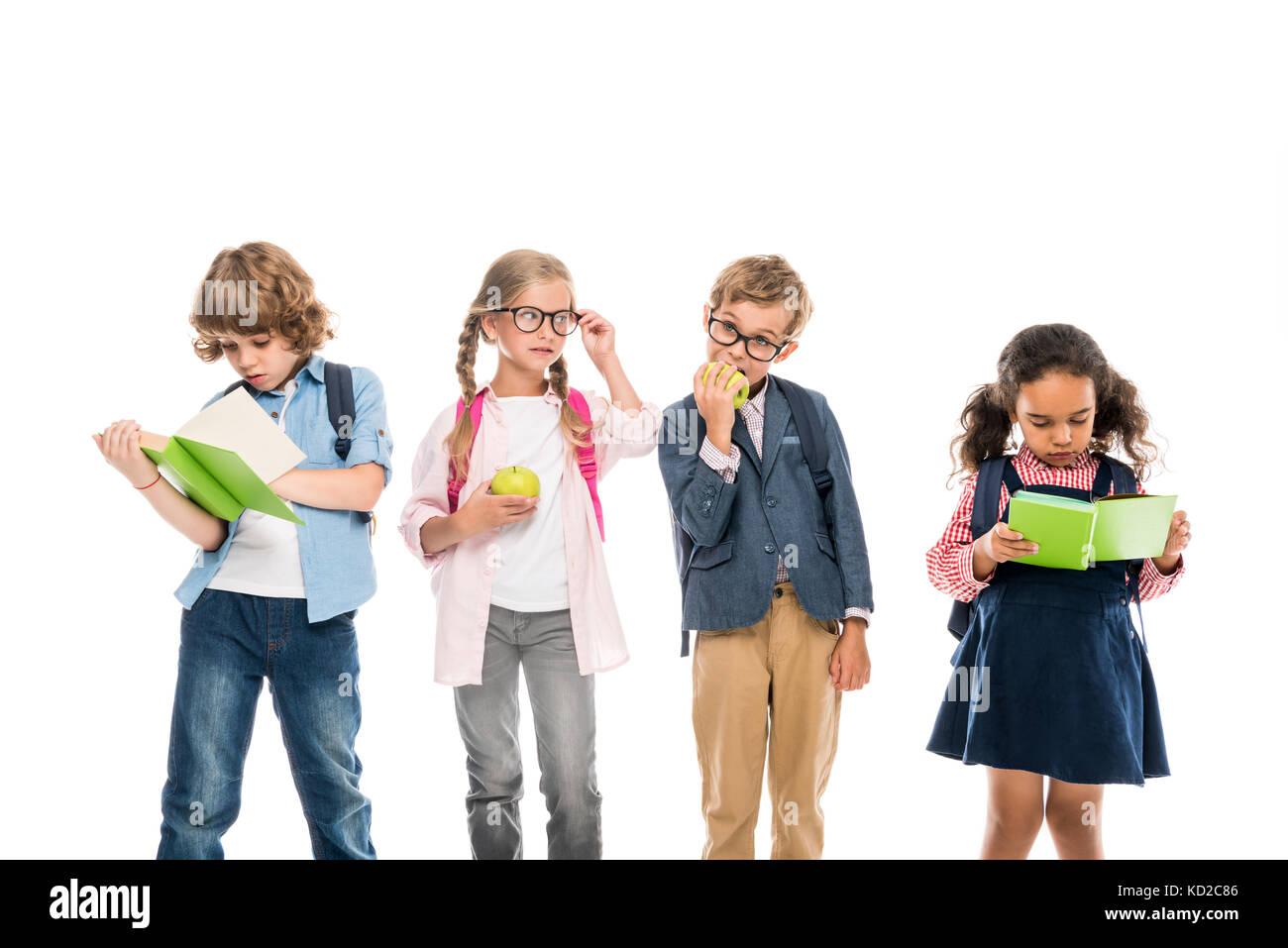multiethnic schoolchildren with books - Stock Image