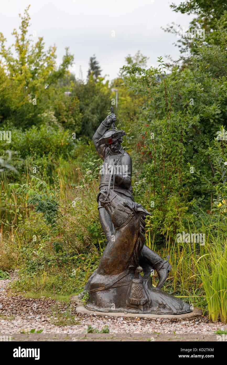 Picture of a Munchhausen sculpture taken in Baron von Munchhausen's town of Bodenwerder, Germany, 20 September - Stock Image