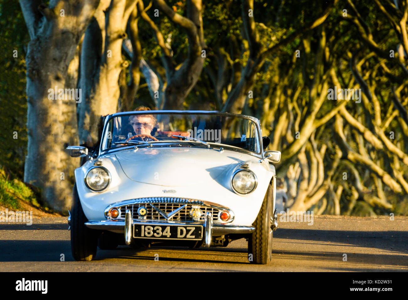 Armoy, County Antrim. Northern Ireland.  10/10/2017 A white Volvo sports car drives along the Brenagh Road, home - Stock Image