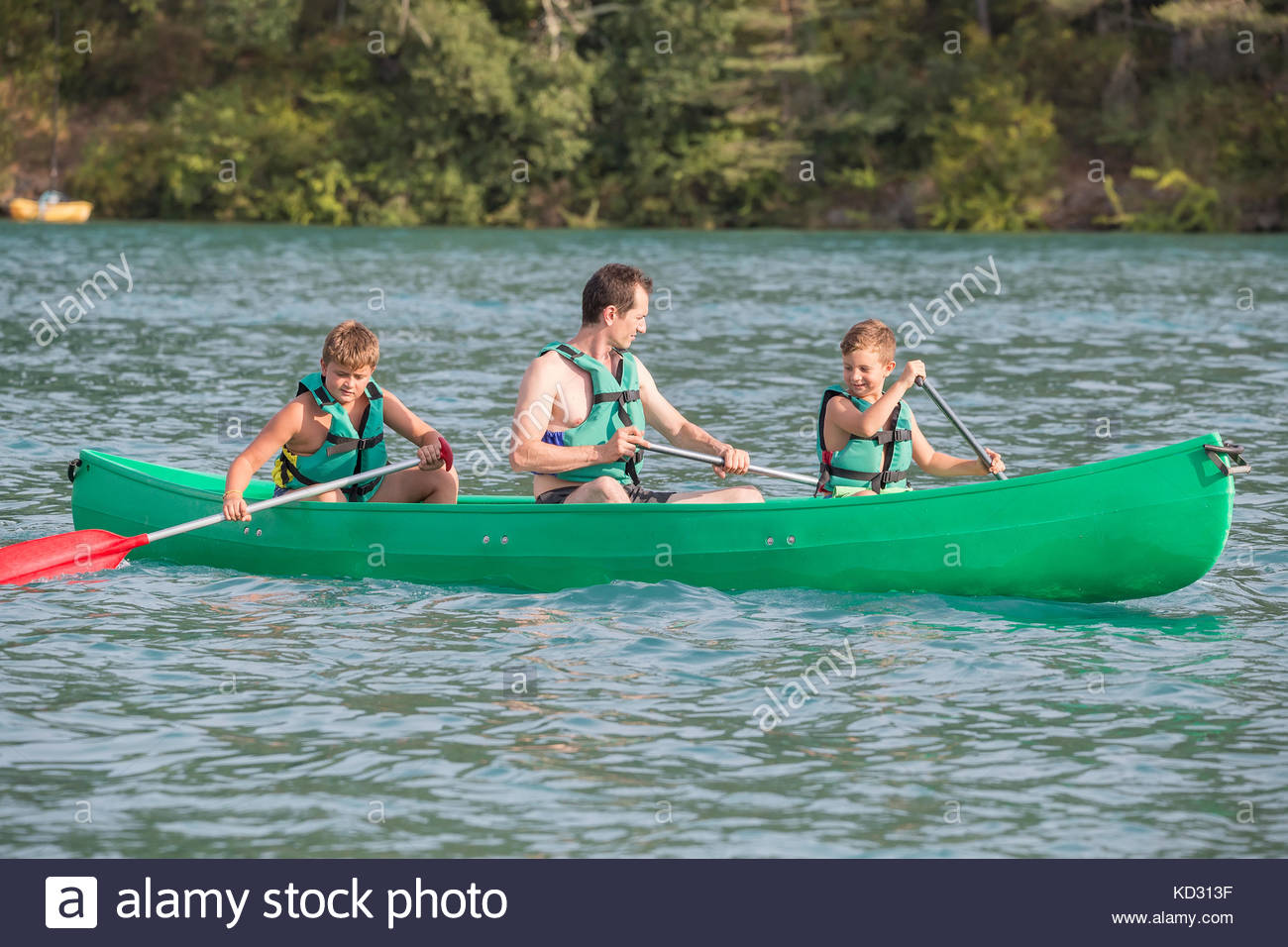 Father and sons in canoe, Esparron-de-Verdon, Provence Alpes Cote d'Azur, France, Europe - Stock Image